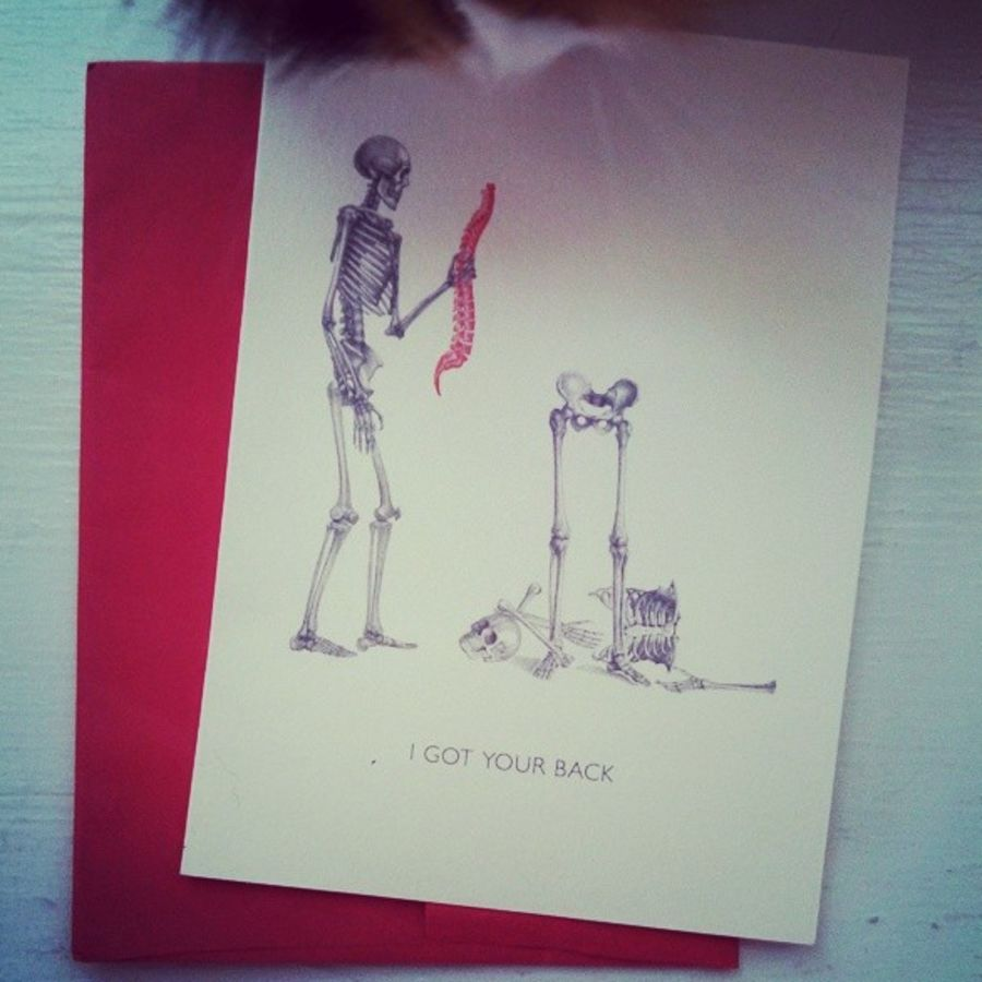 Cover Photo: a card and part of a cat