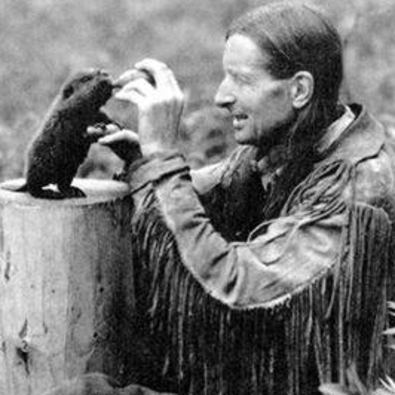 Cover Photo: Grey Owl feeding his beaver kit