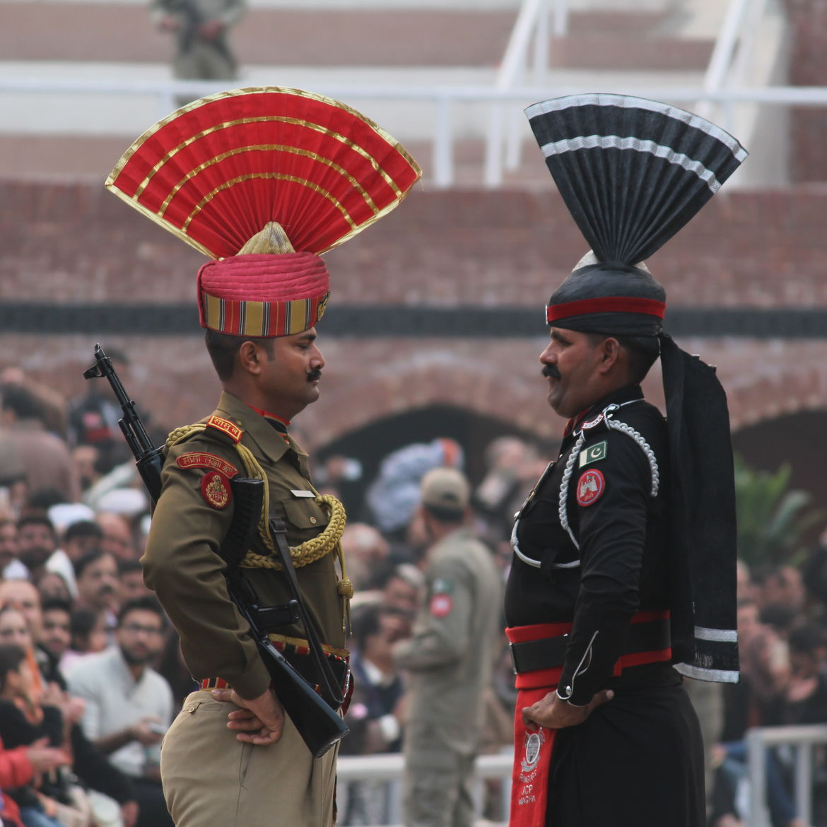 Cover Photo: Beating retreat ceremony at Wagah Border of India-Pakistan/Wikipedia