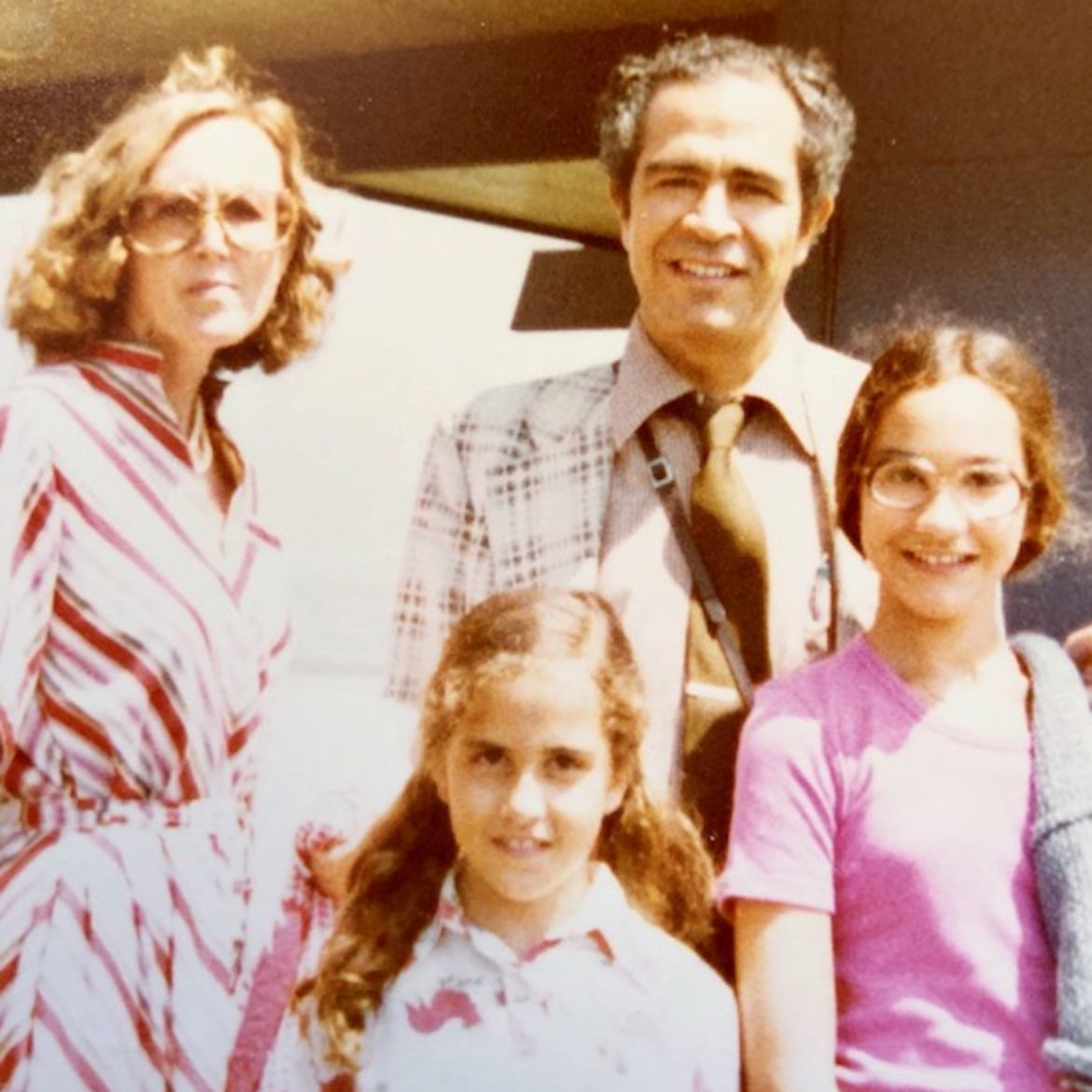 Cover Photo: The author and her family.